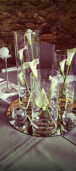 Trio de vases cylindriques en verre et miroir rond