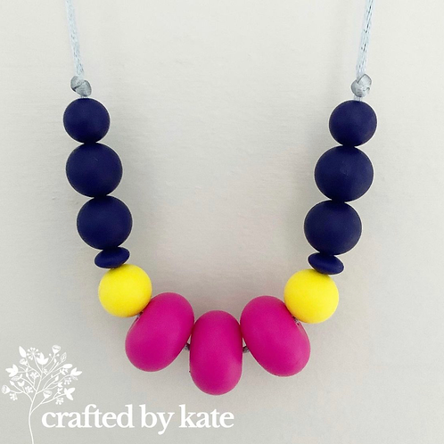 Hot pink and navy teething necklace