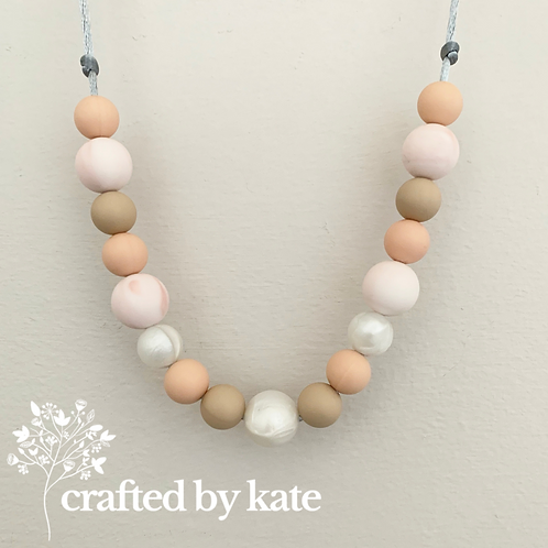 Peaches and cream teething necklace