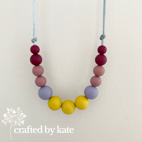 Shades of purple and mustard teething necklace