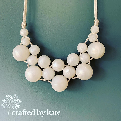 Pearl woven teething necklace - magnetic clasp