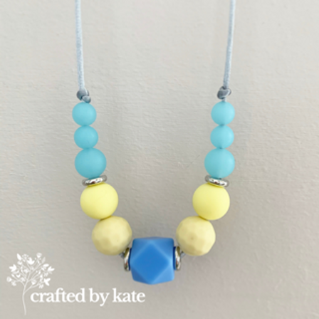 Blue and yellow teething necklace