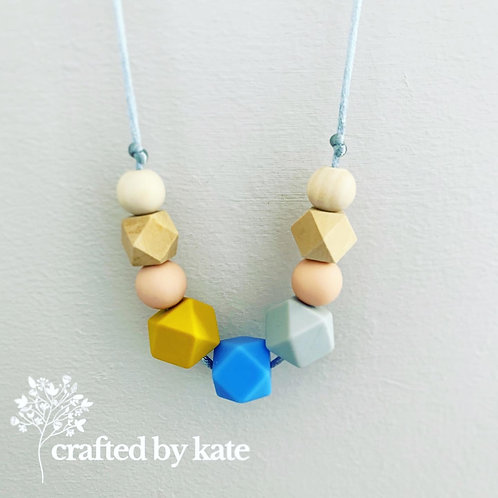 Blue, mustard and peach silicone and wooden teething necklace