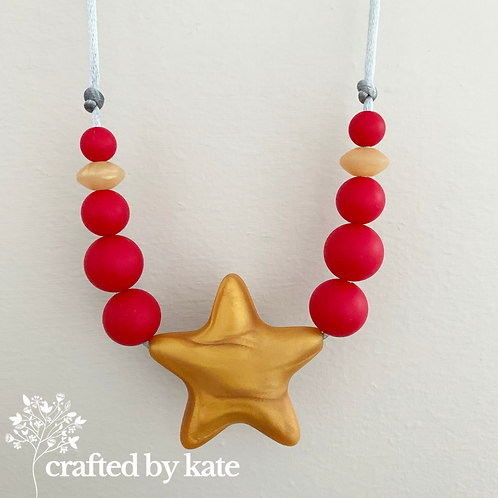 Gold star and red silicone beaded necklace