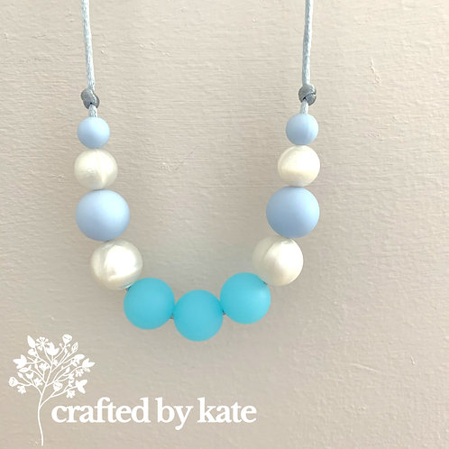 Aqua blue and pearl teething necklace