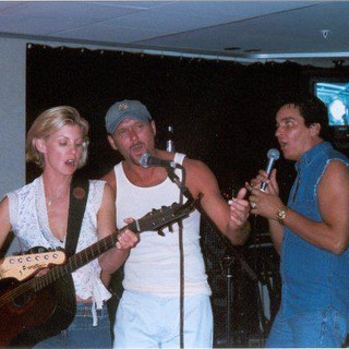 Singing at the end of tour party with Tim and Faith. We were honored to be their guests for that tour of Tim's in 2003!