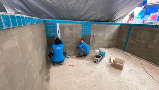 Tiling started today.