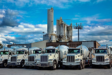 cement-plant-and-cement-mixer-trucks-picture-id992415302.jpg