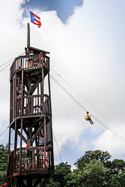 Climbing our fun zipline towers.