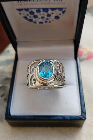 Blue Topaz Sterling Silver Ring with Detailing on Shank