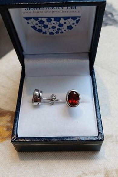 Garnet Oval bezel set stud earrings in Sterling Silver