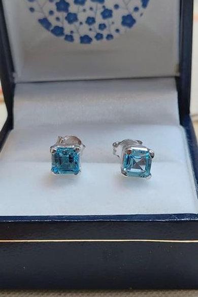 Blue Topaz square cut prong set stud earrings in Sterling Silver