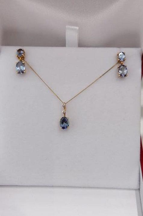 2.39 carat Bi-colour Tanzanite Earring and Pendant set in 9k Yellow Gold.