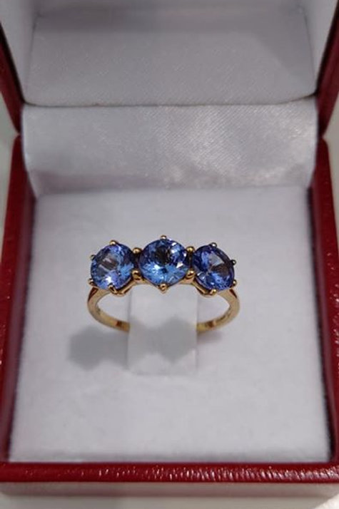 2.22 carat Tanzanite Trilogy ring set in 9k Yellow Gold