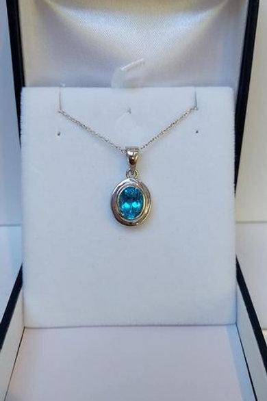 Blue Topaz 8 x 6 mm bezel set Sterling Silver pendant