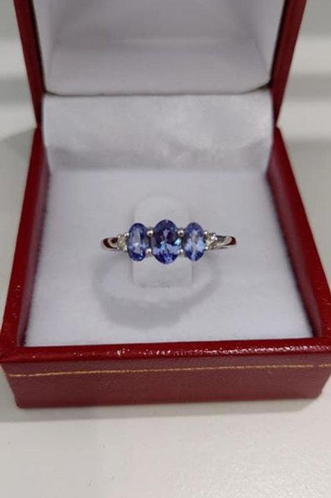 1 carat Tanzanite and Diamond Trilogy ring set in 9k White Gold