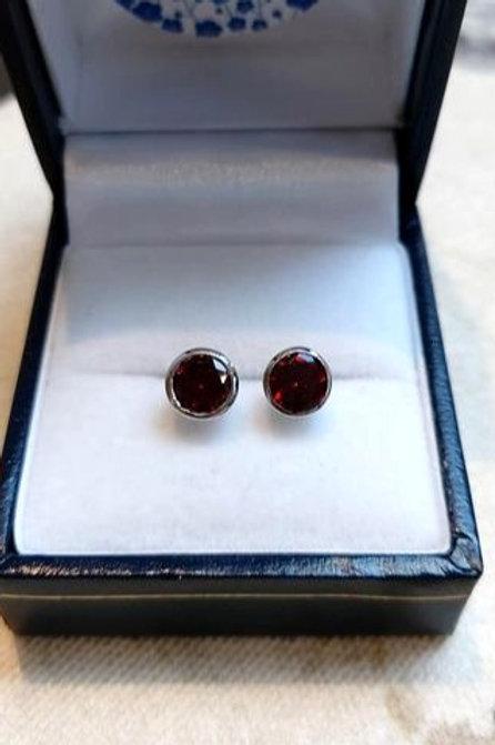 Garnet round cut bezel set stud earrings in Sterling Silver