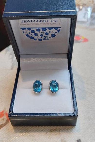 Blue Topaz large oval bezel set stud earrings in Sterling Silver