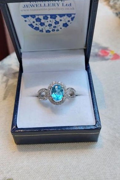 Topaz Blue Ring set with Ice White Natural Zircons in Sterling Silver