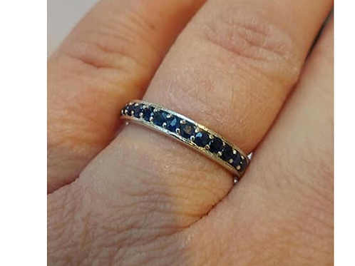 Sapphire Blue Eternity ring set in Sterling Silver on finger
