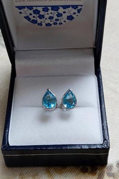 Blue Topaz pear cut bezel set stud earrings in Sterling Silver