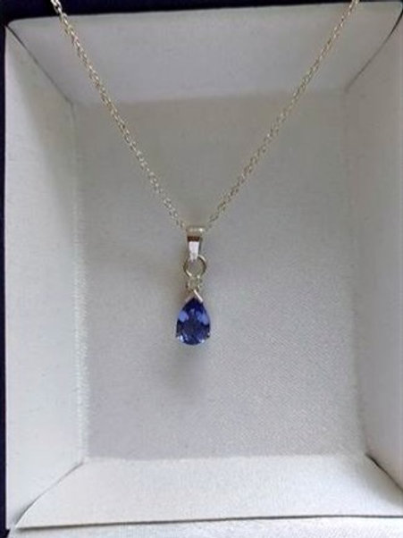 A 7 x 5 mm Pear Cut Tanzanite & Diamond Pendant set in White Gold