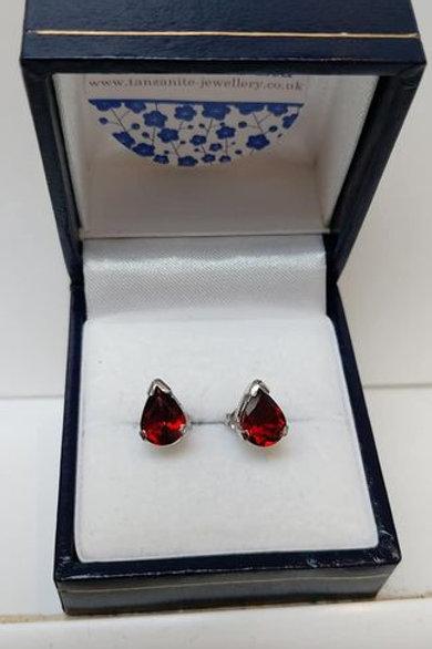 Garnet pear cut prong set Sterling Silver stud earrings