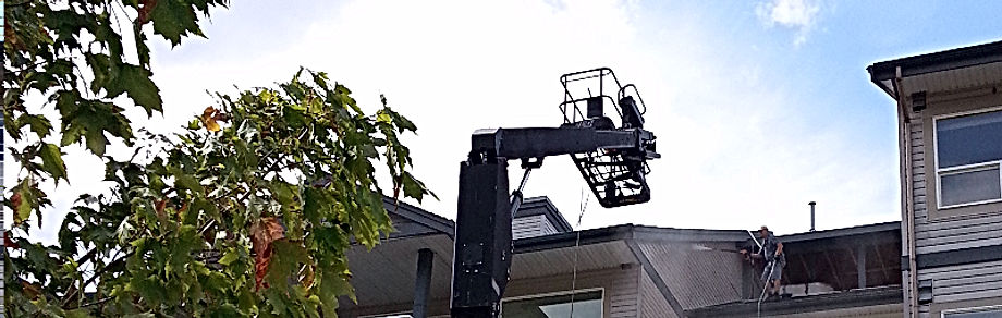 Squamish - Power washing condo building while strapped to safety rope.