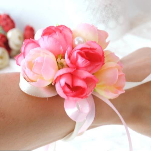 Corsage roze bloemen