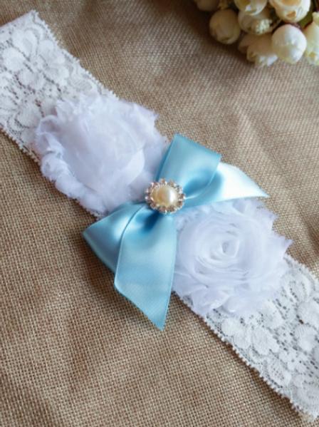 Kousenband tule bloem met blauwe strik