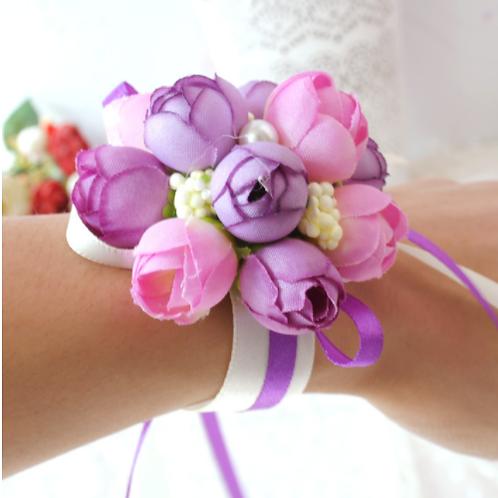 Corsage paars en roze bloemen