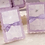 Thumbnail: Trouwkaart paars met een sierlijke print en een strikje