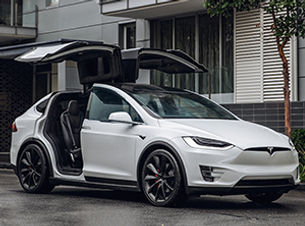 Model X-at building-Web.jpg