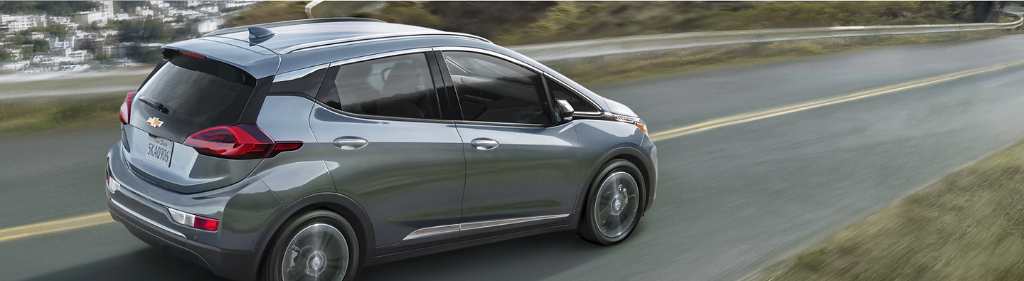 Chevy Bolt Grey on road.png