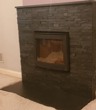 Contura i5 in brick slip built fire surround