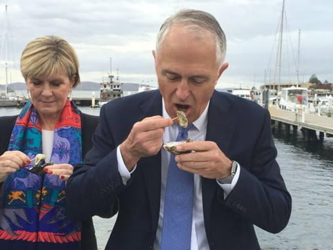 Prime Minister Malcolm Turnbull enjoys an unusual breakfast of oysters in Hobart