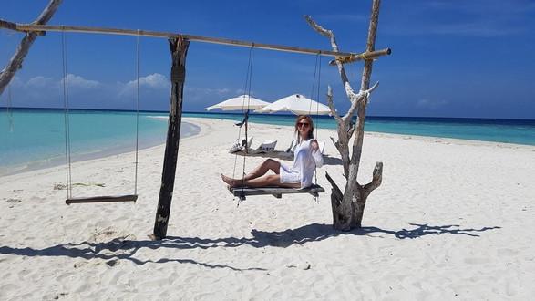 Pihenés a fehér homokos parton