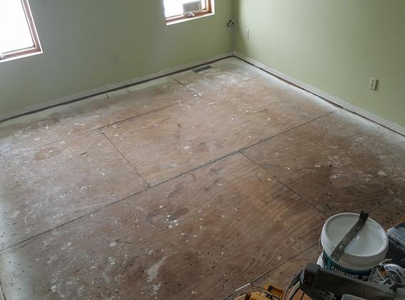 Tile flooring unfinished plywood.jpg