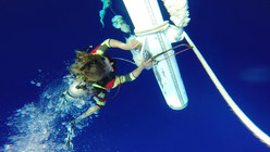 clem in his iron man wetsuite cleaning up the mast to bring back on the ship