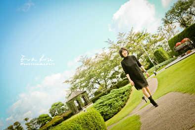 lady on garden path under blue sky