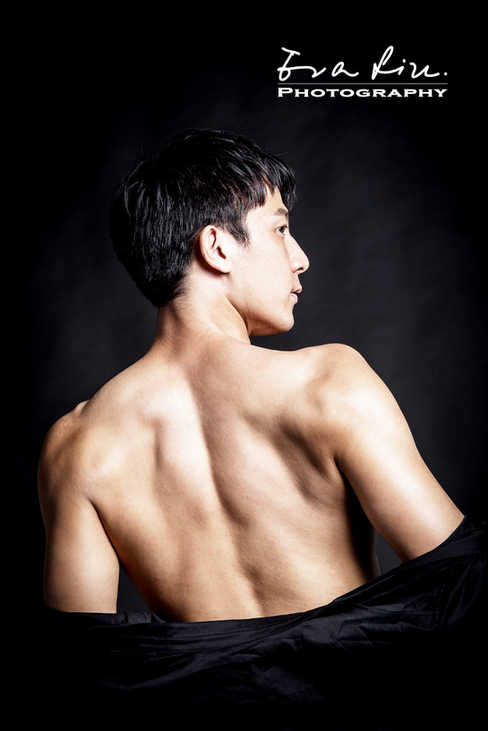 an actor showing off strong back muscles