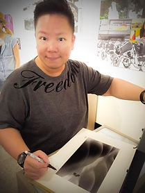 Eva Liu signing a sold print of her photographic work