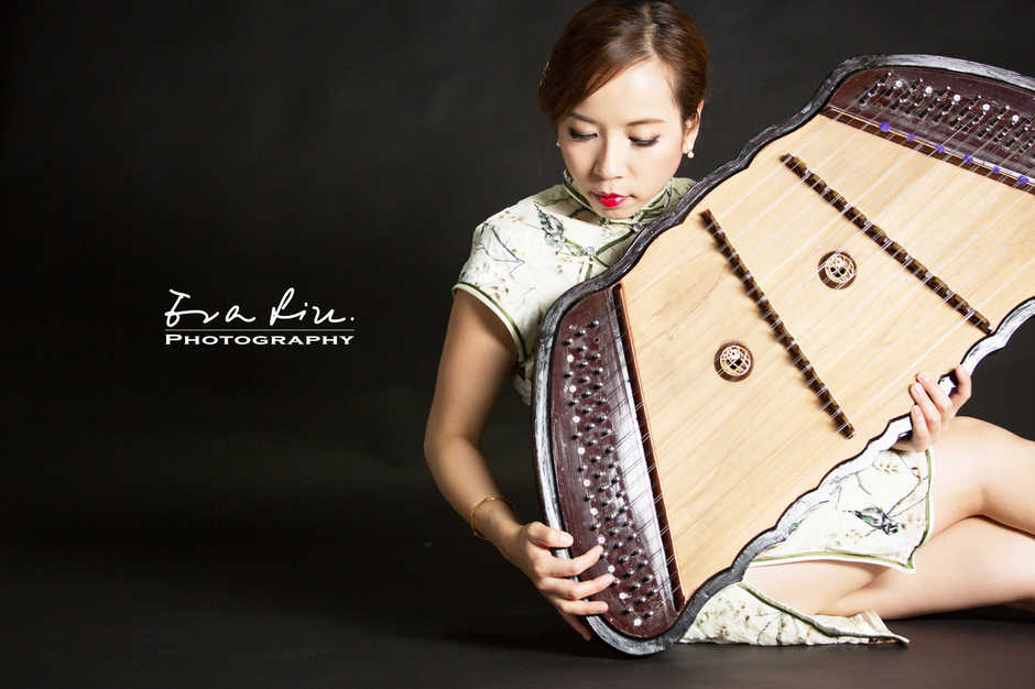 lady holding a chinese musical instrument