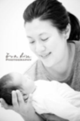mama holding newborn baby sister