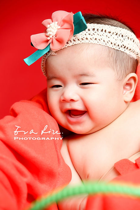 smiling baby in photo studio