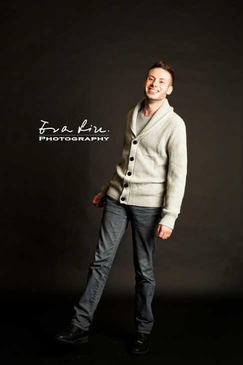 full shot of male model posing in knitwear