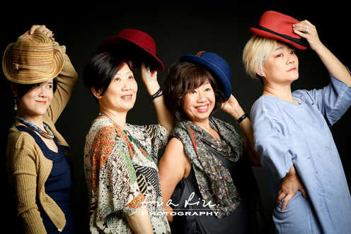 group of ladies with hats