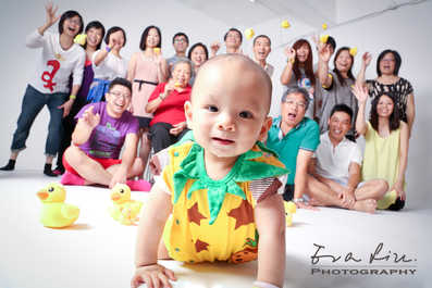 baby is the focus of the whole big family