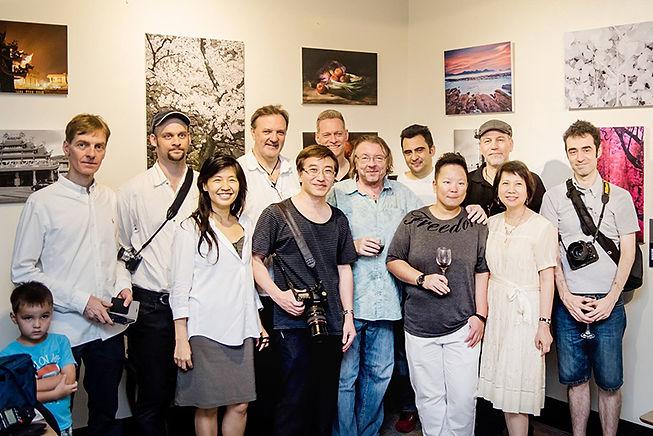 Eva Liu with international photographers at charity exhibition
