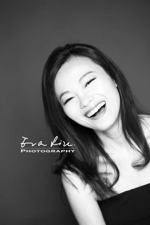 laughing girl in black and white